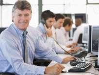 5632070-Stock-Traders-At-Work-Banque-d'images