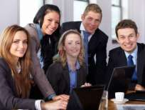 11274343-team-of-5-business-people-during-meeting-blonde-female-work-on-her-laptop-while-other-make-some-rema1