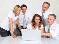 8916226-Group-of-office-workers-in-front-of-laptop-computer-Stock-Photo